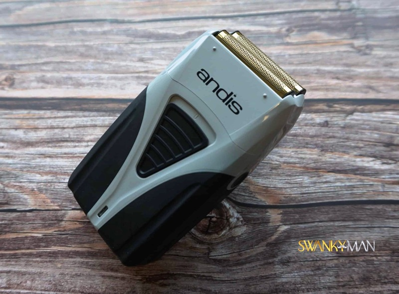 andis profoil plus electric shaver on wooden table