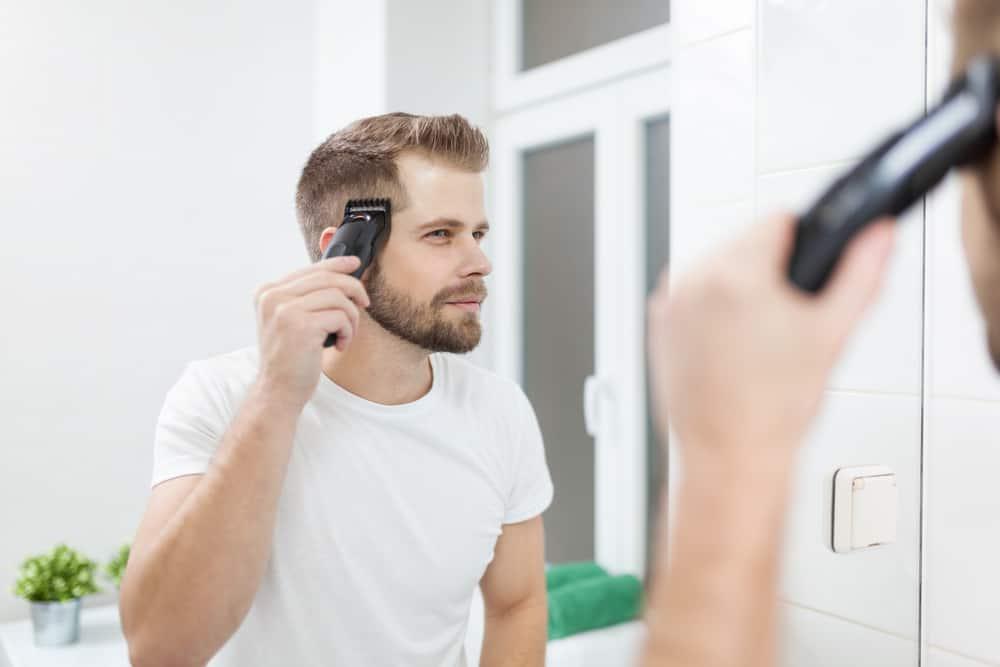 Cutting own hair using hair clippers